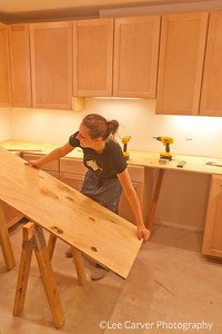 Young wormen doing remodeling. Young women perform numerous construction tasks.