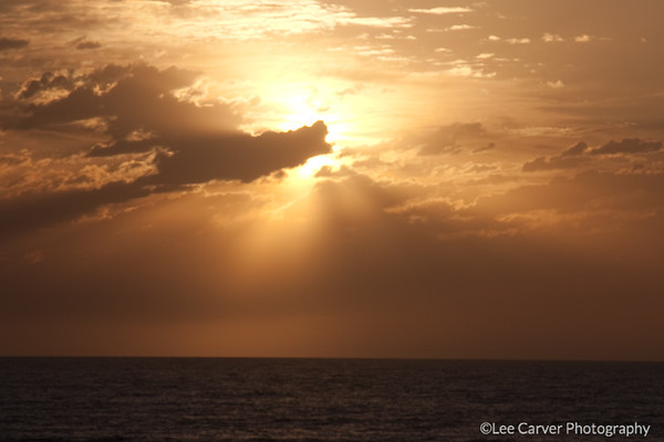 Sunset and Clouds combine with the marine layer offshore to provide rays of hope.