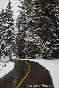 A late spring snowfall brightens the landscape and hides the dirt of the roads.