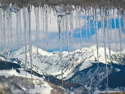 Icecicles add a feeling of cold beauty to an already beautiful mountain scene.