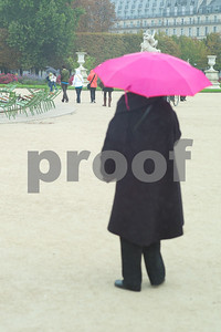 Umbrellas come out to cheer a rainy day in Paris. People continue on Jardin Des Tuileries and Espace Pierre Jardin.