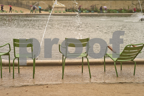 Chairs are in abundance as rain continues in  Jardin Des Tuileries.