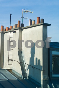 The roof lines and chimneys create theirs own art with shadows and form.