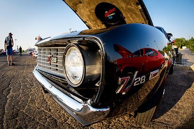 1969 Chevrolet Z28 Camaro reflecting a hotrod Chevrolet Nova