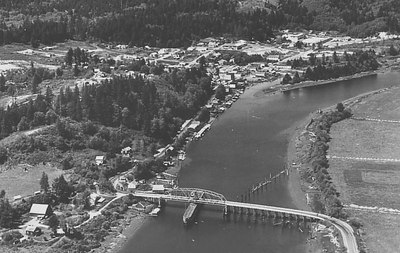 This 1950 aerial shows the position and angle of the original bridge south of the City of Nehalem.