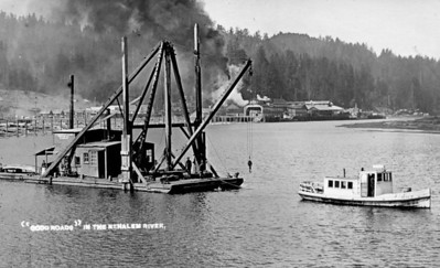 The new road between Nehalem and Wheeler required a bridge. The large building in the background is the Wheeler lumber mill.
