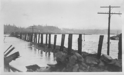 Our watery world on the coast makes Highway 101 a challenge to maintain. Here flood waters in January 1934 have washed away the roadbed between Nehalem and Wheeler.