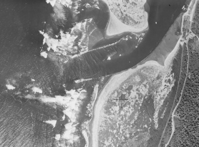Photos from 1953 show both jetties often covered in water. In addition, the original jetties increased accululation of sand on the beaches. The shoreline had moved west, effectively shortening the extent of the jetties into the ocean.