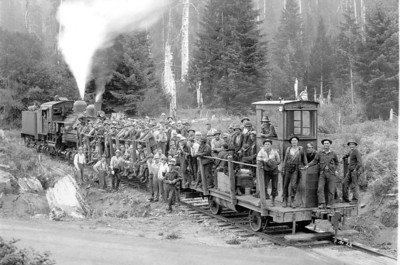 Logging companies built temporary railroads to bring logs from the woods either to the main rail line or to a river for transport to the mill. The Markam and Callow crew shown here operated from their camp along today's Highway 53. Their tracks ran along the west side of the North Fork Nehalem River and ended near the head of tide at the Scovell bridge.