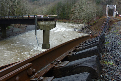 Flooding struck the line again in December, 2007. This image shows the mouth of the Salmonberry River where it enters the Nehalem. The railroad bridge crosses the Nehalem River. The washed out road bridge used to cross the Salmonberry on the road connecting Elsie with Mohler.
