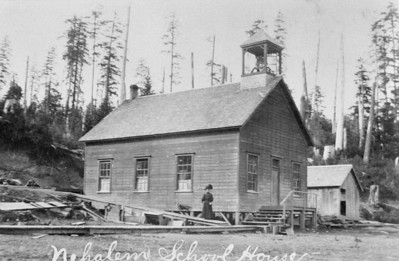 As towns grew, so did schools. This is the first school in Nehalem built around the turn of the 20th Century and located in Uppertown near the west end of MacDonald bridge.