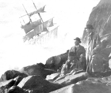 The well-dressed men holding rifles clearly wanted themselves in a photo with the Glenesslin. Were they guarding the ship? Preventing looting? Who knows?    Photo courtesy Columbia River Maritime Museum, Astoria. Album 1997.5.