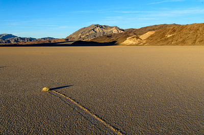 Rocks race across the Playa, Racetrack Playa, Death Valley, California