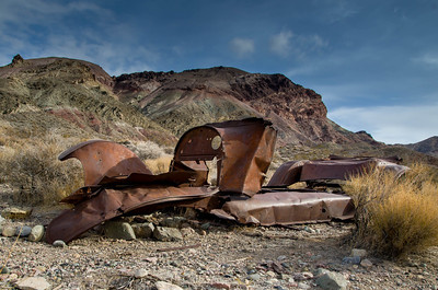 An old car passes time in Titus Canyon, Death Valley, California.