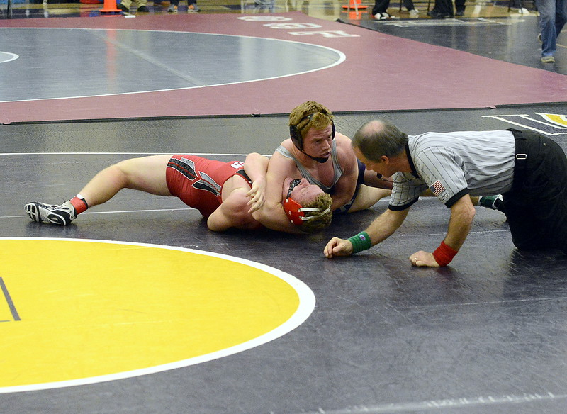 Mountain View's Braden Barker looks to referee Scott Tarbox to slap the mat as he settles Eaton's Jake Sandau to his back ini the 195-pound championship match at the Torgerson Invitational at Fort Collins High School on Saturday. Barker picked up the fall in 1:29.