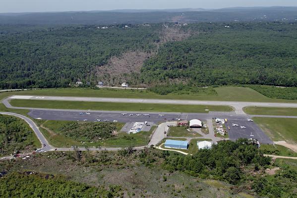 Aerial photo taken 6/7/2011, Southbridge, MA tornado - Looking west across Southbridge Airport.