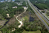 Aerial photo taken 6/7/2011, Sturbridge, MA tornado - Looking north across the tornado path and along Rte 84. Sturbridge DPW and waste water treatment plant are in the middle distance.