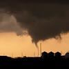 An F1 tornado descends just before sunset on April 24, 2006, near El Reno, OK.