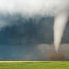 The sun illuminates a brilliant white tornado from behind near Lockett, TX, on April 23, 2021.