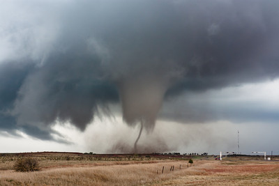 "Just before dissipating, the Manitou, OK, tornado of November 7, 2011, exposes its intense core circulation. The dissipation phase of a tornado's life cycle is often called ""roping out,"" and this is one of the most visually impressive examples storm chasers have seen in recent years!"