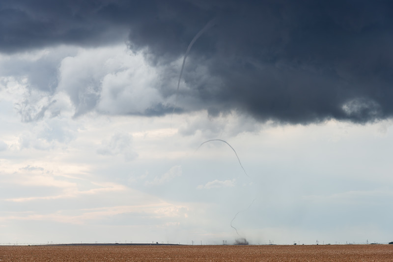 A sinuous rope tornado churns up dirt over barren fields on the Caprock near Sudan, TX, on May 16, 2021.