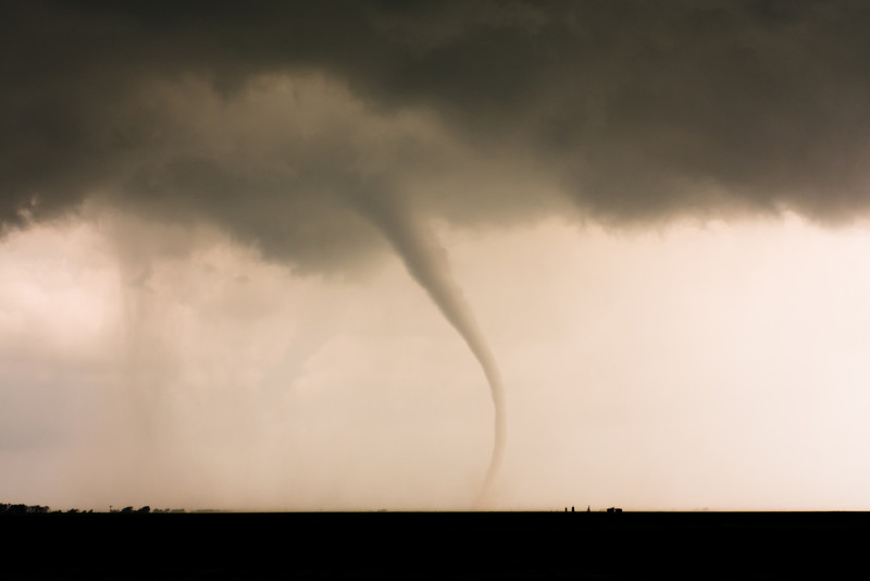 """A classic """"elephant trunk"""" tornado ropes out with deceptive grace west of Cherokee, OK, on April 14, 2012."""