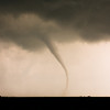 "A classic ""elephant trunk"" tornado ropes out with deceptive grace west of Cherokee, OK, on April 14, 2012."