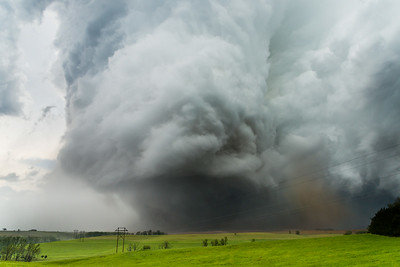 A violent EF-4 wedge tornado churns across the rolling hills north of Stanton, NE, on June 16, 2014.