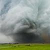 A violent EF-4 wedge tornado churns across the rolling hills north of Stanton, NE, on June 16, 2014.