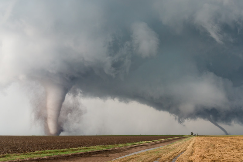 A violent stovepipe tornado (left), along with a smaller rope tornado (right), loom large over wheat fields south of Dodge City, KS, on May 24, 2016.