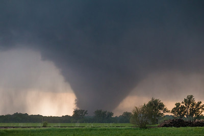 A violent wedge tornado churns just west of Bennington, KS, on May 28, 2013. Mobile doppler radar measured winds in excess of 200 mph within this vortex.
