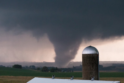 A violent tornado rips trees from the ground near Climbing Hill, IA, on October 4, 2013. This tornado soon grew to 1.5 miles wide and was rated EF-4.