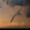 A tornado dissipates near Rozel, KS, at sunset on May 18, 2013.