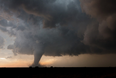An exceptionally photogenic tornado churns near Rozel, KS, on May 18, 2013, surrounded by a dry rear-flank downdraft.