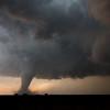 An exceptionally photogenic tornado churns near Rozel, KS, on May 18, 2013, surrounded by a dry rear-flank downdraft.