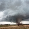 A powerful tornado unearths major dirt and debris over open country near Manitou, OK, on November 7, 2011.