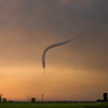 A tornado near Sanford, KS, briefly takes on a rare appearance in which the condensation funnel is truncated at both the top and bottom. Shot at sunset on May 18, 2013.
