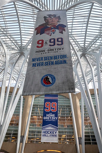 Inside the building that houses the Hockey Hall of Fame are banners for the Gordie Howe and Wayne Gretzky exhibit.