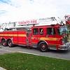 Aerial 142<br /> <br /> Shop #: 27017<br /> Cab/Chassis: 2001 Spartan Gladiator FF<br /> Manufacturer: Smeal<br /> Pump: 1750 gpm<br /> Tank: 500 gal.<br /> Ladder: 105'<br /> <br /> Photo by Kevin Hardinge