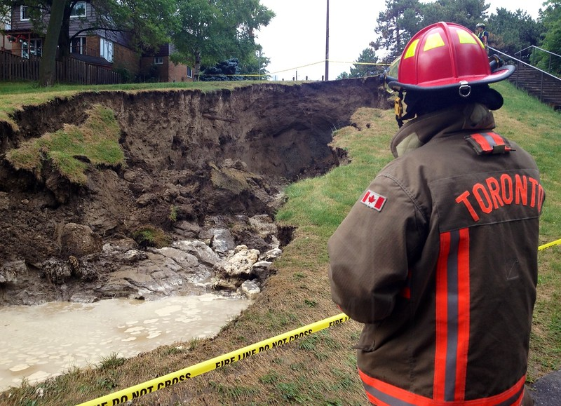 A231 capt surveys the damage done after a sinkhole formed in Cedarbrook Park during Sunday's thunderstorm. <br /> <br /> Photo by John Hanley