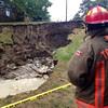 A231 capt surveys the damage done after a sinkhole formed in Cedarbrook Park during Sunday's thunderstorm. <br /> <br /> Photo by John Hanley