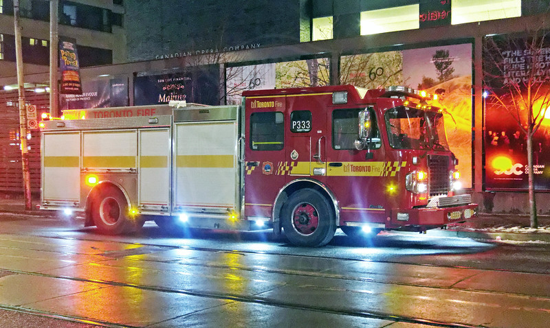 Pumper 333 on the scene of a small fire on Richmond St. West.<br /> <br /> Photo by Kevin Hardinge