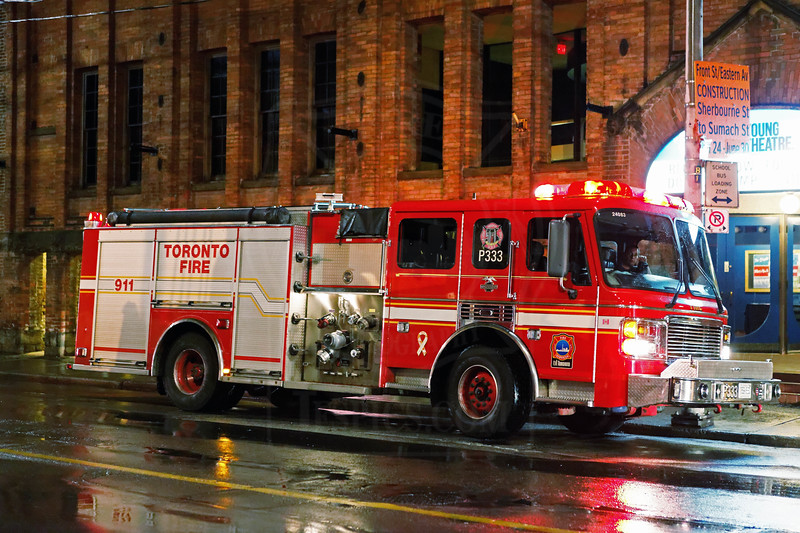 Pumper 333 at an alarm call on Front St. East, July 23, 2011.<br /> <br /> Photo by Kevin hardinge