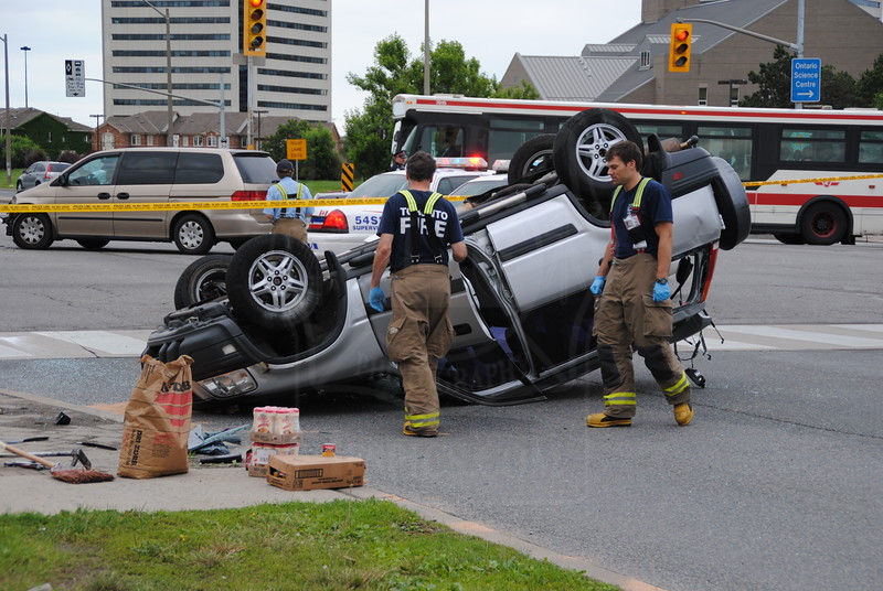 Pumper 125 on the scene of an SUV rollover at Don Mills & Eglinton, June 25, 2011.<br /> <br /> Photo by Larry Thorne