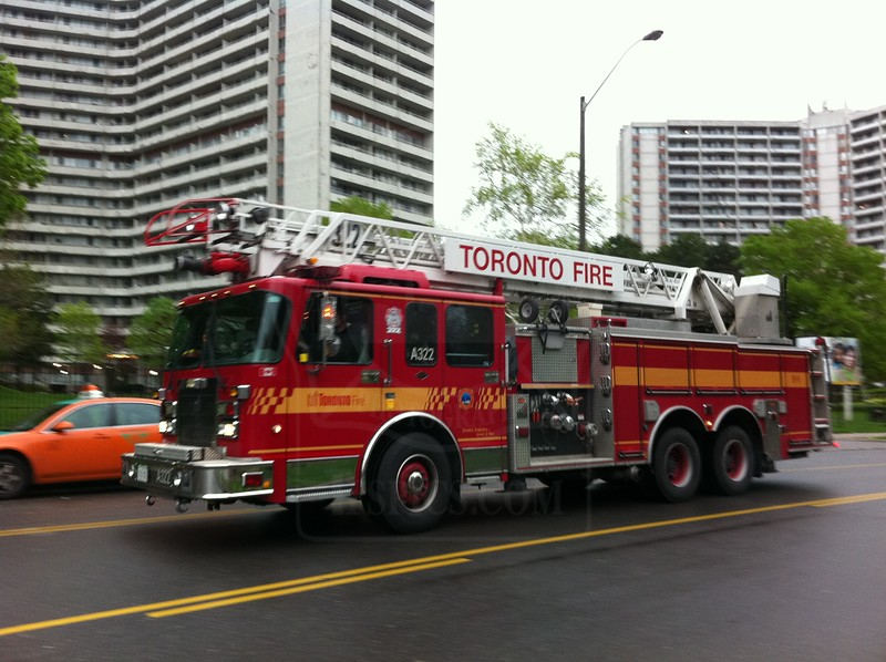 Aerial 322 operating at a working fire on Thorncliffe Park Dr., May 15, 2011.  <br /> <br /> Vehicle fire in an underground garage.<br /> <br /> Photo by Larry Thorne