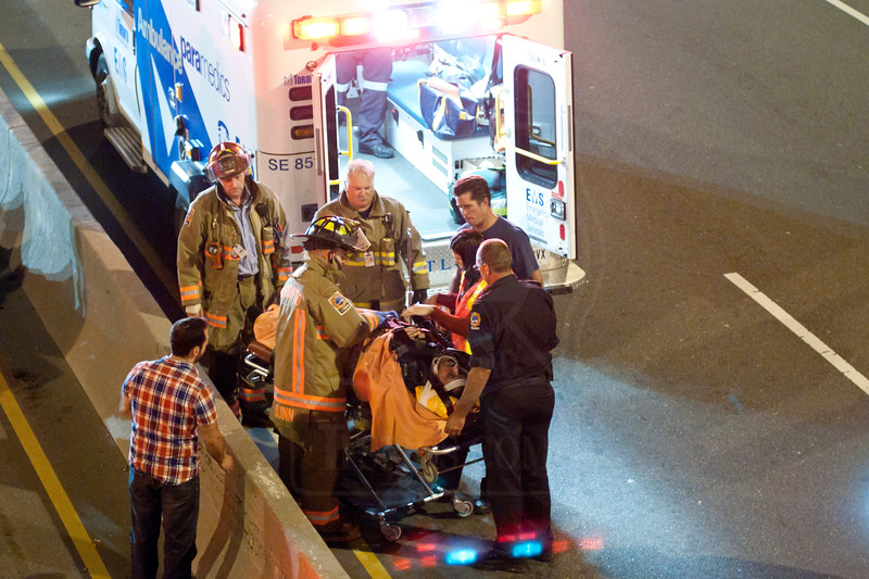 TFS on the scene of a motorcycle accident on the Don Valley Parkway, July 1, 2011.<br /> <br /> Photo by Louis Tam