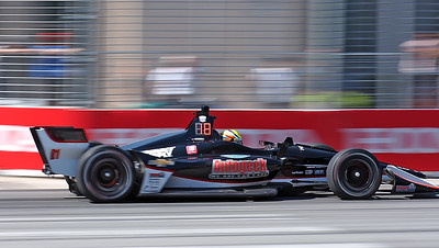 Spencer Pigot in the Ed Carpenter Racing car passing the Enercare Center.