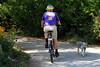 Cyclist and Dog on Path