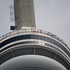 EdgeWalk lets thrill-seekers walk hands free along a 1.5-metre-wide ledge around the top of the tower's main pod.<br /> <br /> Walkers get suited up in fire engine red jumpsuits and yellow harnesses for a stunning, open-air view of Toronto and Lake Ontario from 356 metres above the ground.<br /> <br /> Safety harnesses and industrial-strength cables attach walkers to an overhead rail, allowing them to lean off the edge of the platform and gaze out on the city sprawling below.<br /> <br /> The experience costs $175 and lasts a total of 90 minutes, with the walk itself taking 20 to 30 minutes. Trained guides lead the walkers in groups of six to eight.