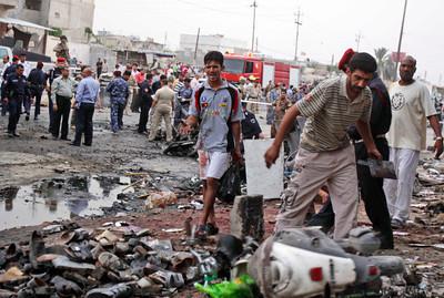 100 Killed in Iraq Suicide Attacks